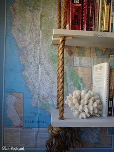 LOVE. Hanging bookshelves.  Seeing this above the well-loved table/desk I don't own yet.
