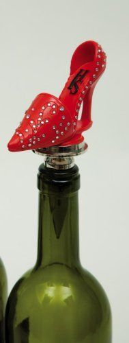 """Red High Heel Bottler Stopper by Evergreen Enterprises, Inc. $19.99. Silicone rings seal in freshness. Metal base and silicone o-rings to seal in freshness. Metal base. 3.25""""L x 1.25""""W x 6""""H. This red high heel bottle stopper has a durable metal wine stopper with a hardy rubber stop for a tight seal. This is a fun and flirty bottle stopper  it's a unique gift for any wine diva!  Size: 6'H x 3-1/4'W"""