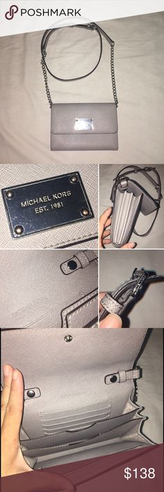f6b02b4ff6268b Michael Kors Jet Set Phone Crossbody Great condition authentic MK crossbody  in gray MK hardware plate in front is slightly scratch and the studs are ...
