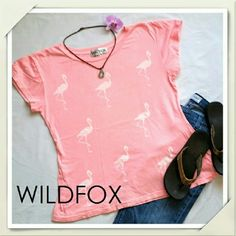 Wildfox Soft Pink Flamingo Tee Never worn Wildfox tee. Pink with white flamingos on front and back. Super soft, lightweight, and adorable. Washed once, but never worn. No flaws. Runs large. Wildfox Tops Tees - Short Sleeve
