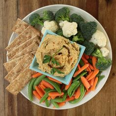 This roasted garlic hummus is the perfect dip for pita crisps and fresh vegetables for a healthy, homemade snack. To make the crisps, simply bake triangles of pita bread in a hot oven until they are golden, about 8 minutes. Healthy Bread Recipes, Vegan Recipes Videos, Vegan Recipes Easy, Healthy Foods To Eat, Healthy Dinner Recipes, Healthy Snacks, Vegetarian Recipes, Healthy Eating, Healthy Hummus
