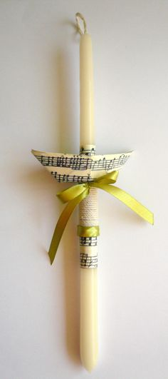 Easter candle decorated with a paper boat. https://www.facebook.com/BeadABoo