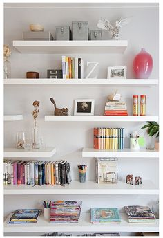 i wish a magical fairy would come install shelves like these in my house.