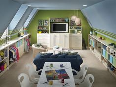 I love this play room! From the side bookshelves, dress up area, movie watching, arts and crafts table...love it!