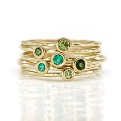 Scarlett Jewelry: Emerald, Peridot, and Tourmaline Stacking Ring Set. Love this! I would add blue topaz and turquoise and a white metal and it would be a unique and perfect for me mother's ring:)
