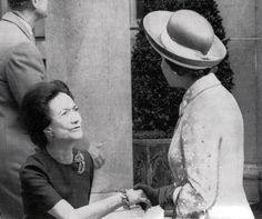 The Duchess of Windsor (formerly Wallis Simpson) curtsying to Queen Elizabeth II, when The Queen, The Duke of Edinburgh, and The Prince of Wales went to visit The Duke of Windsor (formerly King Edward VIII) during his final illness.