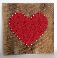 Large Red string art wooden heart sign. A unique gift for Weddings, Anniversaries ,Birthdays, Valentine's Day, Christmas, new baby, house warming and just because. Celebrate love with this handmade heart statement. Made on re purposed barn wood, making each piece special and unique. Comes wall ready with hanger in place. Great gifts for birthdays, weddings, anniversaries, Mother's Day and of course Valentine's Day. Perfect accents for the home, office or nursery. Give the gift of Art....