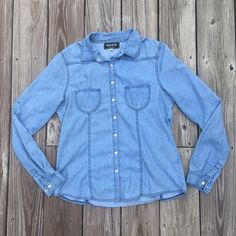 Adorable denim jacket! Has circle cut out on the back. 2 pockets on each side of the front. Jackets & Coats Jean Jackets