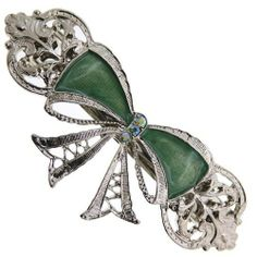 1928 Jewelry Antique Delight Forest Green Enamel Bow Barrette by 1928 Jewelry. $13.00. Ditch the ribbon and put this beautiful bow barrette in your hair instead! Without the wrinkles and the hassle of tying the perfect bow, this beautiful silver tone barrette adds a feminine bow to your hair style with ease. Beautiful green enamel fills in the bow design and is accented with green aurora borealis crystals and a filigree design.    For those who love all things...
