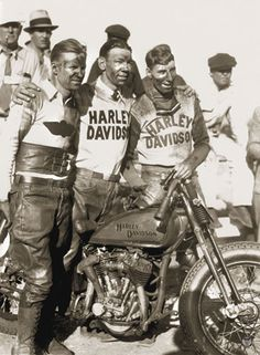 "acers pictured with a 1929 DLD ""Privateer"" racer. A ""privateer"" was a racing bike that was built without the help or sponsorship of the original manufacturer, as opposed to the Harley-Davidson factory race models. The photo was taken at the Ascot Park races in Los Angeles, on September 22, 1935"