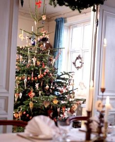 A real Christmas tree,decorated with paper cones,Danish flags ,and other Christmas decorations, in Denmark. Danish Christmas, Real Christmas Tree, Christmas Feeling, Holiday Tree, Scandinavian Christmas, Winter Christmas, Merry Christmas, Christmas Table Settings, Christmas Decorations