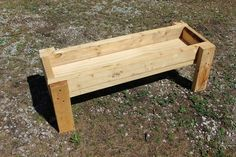 Easy to build hog trough, homemade pig feeder. Directions on building a livestock feeder.