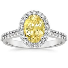 Platinum Sapphire Fancy Halo Diamond Ring with Side Stones from Brilliant Earth - Yellow sapphire is stunning in this cut. Love, Pammy
