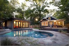 Wouldn't mind a pool and guest house/office/studio space one day. :: modern pool by Risinger Homes
