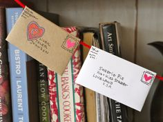 make a Valentine's banner full of little love notes, super cute idea~I have a box of mixed match envelopes, which I plan to decorated.