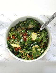 Brussels sprouts kale salad with bacon, almonds, blue cheese, and a lemon garlic vinaigrette.