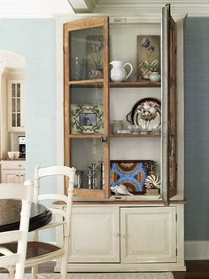 lovely combo: unpainted wood doors add a rustic touch to this painted hutch