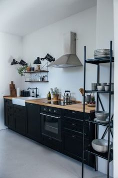 A compact Ikea country kitchen outside Berlin by the creative couple behind Our . - Ikea DIY - The best IKEA hacks all in one place Black Kitchens, Home Kitchens, Ikea Kitchens, Best Ikea, Cuisines Design, Diy Kitchen, Black Ikea Kitchen, Small House Kitchen Ideas, Timber Kitchen