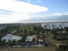 The Forum building and adjacent polo field at Empire Polo Club.