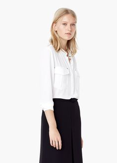 Witte blouse (zoals mijn Mexx en Mango hemd, maar dus in't wit e :p) dit is voorbeeld van Mango (30 euro)
