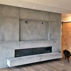 Discover the hallmark of a truly well-appointed home with the top 60 best concrete fireplace designs. Explore luxury and minimalistic interior ideas. Tv Above Fireplace, Wooden Fireplace, Concrete Fireplace, Home Fireplace, Fireplace Design, Fireplaces, Fireplace Ideas, Beton Design, Concrete Design