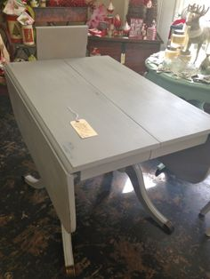 This antique Duncan Phyfe table needed a new finish, so we painted it using Annie Sloan's Paris Grey paint, lightly distressed it, and finished with an amber wax from Maison Blanche.  It includes a leaf and can seat 10-12 people.  Beautiful!  www.facebook.com/spottedcowvintage