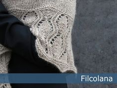 Tiliana is generously sized triangle-shaped shawl knit with two strands held together in a combination of stockinette stitch and an easy-to memorize lace pattern.