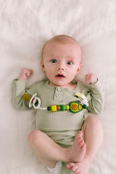 White Tossed Baby Feet Universal Pacifier Holder