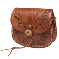 This handcrafted Moroccan leather cross-body bag features an intricately hand-punched and embossed design across the flap and front panel of the main compartment, and includes an exterior zippered pocket for the perfect bag to tote your essentials.