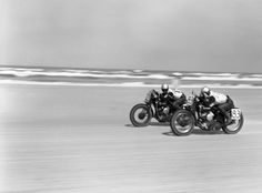 Unpublished. Low on their bikes, two racers speed neck and neck across the sand during the Daytona 200, Daytona Beach, Florida, in March 1948.