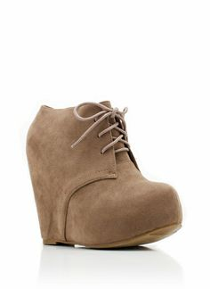 Lace-Up Bootie Wedge @Laurel Wypkema Wypkema Wypkema Bray Robertson... I have a pair of these, they're super cutie but after a while my feet can't stand it and get all swollen:-/