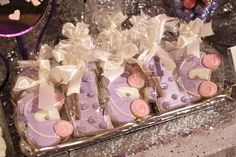 First Birthday Princess Party dessert table with shine and shimmer. Purple and pink desserts with sparkle backdrop and tablecloth was magical. Princess carriage sugar cookies and #1.