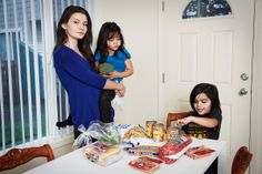 Jennifer Noonan at home with her two children, Portland, Ore. Before the cut, she was receiving $524/month in SNAP benefits. Now she receive...