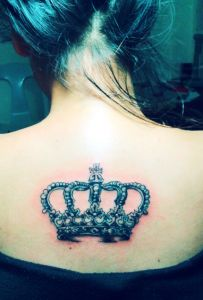 crown tattoo. except smaller. & more on the back of neck.