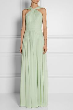 """A mint green pleated silk-chiffon Elie Saab gown.  """"Part of the Resort '15 collection, Elie Saab's floor-sweeping gown is cut from mint silk-chiffon that flatters any skin tone. The pleats and straps are positioned to suit both athletic or curvaceous figures, and contoured boning means you don't need to wear a bra. Style this silk-lined piece with classic accessories."""""""