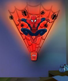 Add excitement to the wall with this interactive decal set. The peel-and-stick decals easily affix to any smooth surface, and the FX activator triggers synchronized lights and sounds to bring the thrilling Spider-Man to life.