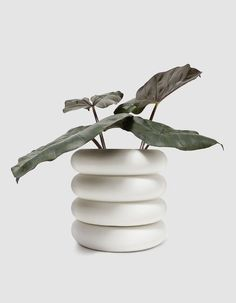 High voltage ceramic insulator-inspired planter from Chen Chen & Kai Williams in White. Glazed interior. Unglazed exterior. Drainage holes. Includes planter and saucer.  • Porcelain • Made in USA