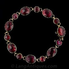 Exquisite Antique French bracelet crafted in 18 karat rose gold. Raspberry red rose cut garnets, alternating with small round and large oval, are foil-backed in cut down collet settings typical of the Georgian period. This bracelet also features a safety chain with hidden box clasp and is best suited for a small wrist due to the 6 1/2 inch length. French hallmarks.Condition: GoodCirca: 1820