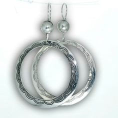Boucles d'oreilles Touareg en argent 925, ronde plates forme créole. Bijouterie Touareg.