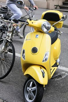 Vespa. @Katrina Troyer we really need to invest in a couple of these. Don't you think it would be a good investment. I think so. We could be known as those ladies that ride around on those adorable little thingys.