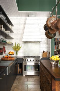 layout, this is similar to how much spave we'd have in our kitchen...  love the island and pot rack, the open shelves, the wood, the black and white.  dude.  i'm not in love with the choice of tile, but everything else is spot on.