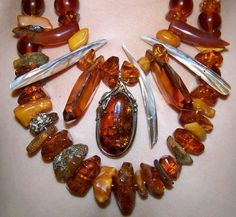 Beautiful and very unique two-string  Baltic amber necklace with 14k white gold beads, mother of pearl,  50mm Baltic amber pendant with fossils in sterling silver, two Swarovski golden topaz  50mm art-cut crystals, freshwater pearls and black onyx.  Sterling silver clasp.  22'