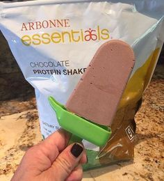 Chocolate Popsicle Ingredients: 1 cup unsweetened vanilla almond or coconut milk 2 scoops Arbonne Chocolate protein (adjust scoops based on your chocolate tooth) 2 tablespoons almond butter (optional) Optional 1 1/2 cup fresh strawberries Instructions: Blend all ingredients . Pour mixture into Popsicle Molds leaving about 1/2 inch room (the mixture will expand). Freeze for at least four hours. Option: Add a few slices of strawberries to the bottom of each popsicle mold.