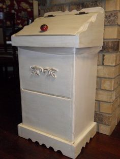 French country trash can.  I recently bought one almost just like this from Goodwill...looking forward to giving it a needed makeover :)