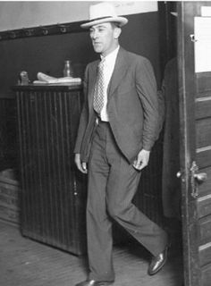"""Samuel McPherson Hunt aka Sam """"Golf Bag"""" Hunt (1898 -August 19, 1956) was a Chicago Gangster and an Enforcer for Al Capone`s Chicago Outfit. A hitman whose techniques included tracking prey with a shotgun in a golf bag. To an inquiring police officer, he said, """"I'm going to shoot some pheasants."""" One man, shot by Golf Bag, failed to die and was thereafter known as """"Hunt's hole-in-one."""" Real Gangster, Mafia Gangster, Gangster Style, Famous Outlaws, Mafia Crime, Chicago Outfit, Mafia Families, Sam Hunt, Life Of Crime"""