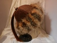 Raccoon fur, with quilted suede, horse hair tassel intriguingdesigns.net