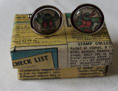 Teenage Mutant Ninja Turtles Cufflinks// Raphael and Donatello// Recycled comic Cufflinks// Marvel comic cufflinks. £12.00, via Etsy.