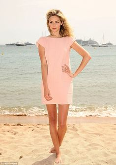 Cannes 2014.  Barefoot in the sand: Tamsin Egerton strikes a pose at the water's edge during the photocall for Queen & Country