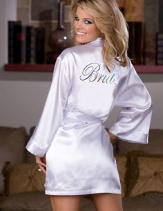 "Beautiful bridal robe set with attached belt and ""Bride"" silver heat transfer on back. Includes a V-neck chemise with adjustable low back, long sleeve robe, and, padded lingerie hanger. $27.95."