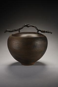 "Carol Green  |  ""Terra Gourd"" ceramic vessel (10.0in H x 12.0in W10.0in diameter).  ""The body of my work reaffirms the artist's historical role as a maker of objects for utility, pleasure, and symbolic meaning.""  Each vessel is wheel thrown using mica clay, has a spun copper lid and a cast bronze handle created using lost wax casting."